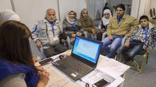 Syrian refugees hoping to go to Canada are interviewed by authorities in Amman, Jordan, in November, 2015. (Paul Chiasson/THE CANADIAN PRESS)