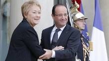 Quebec Prime Minister Pauline Marois, left, is accompanied by France's President Francois Hollande after their meeting at the Elysee Palace in Paris, Monday, Oct. 15, 2012. (Francois Mori/Associated Press)