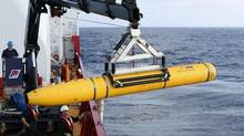 Crew aboard the Australian Defence Vessel Ocean Shield move the U.S. Navy's Bluefin-21 autonomous underwater vehicle into position for deployment in the southern Indian Ocean to look for the missing Malaysia Airlines flight MH370, April 14, 2014 in this handout picture released by the U.S. Navy. (© Handout . / Reuters)