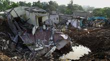 Sri Lankan military personnel use heavy machinery as they search for possible survivors at the site of a collapsed garbage dump in Colombo, on April 16, 2017. (ISHARA S. KODIKARA/AFP/Getty Images)