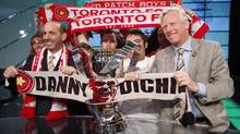 Major League Soccer commissioner Don Garber, left, and Toronto mayor David Miller pose with fans after making an announcement to host MLS's championship soccer game, the 2010 MLS Cup, at BMO stadium in Toronto, March 30, 2010. (Reuters)