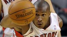 Toronto Raptors forward Leandro Barbosa intercepts a pass against the Indiana Pacers during the first half of their NBA basketball game in Toronto March 11, 2011. REUTERS/Mike Cassese (MIKE CASSESE)