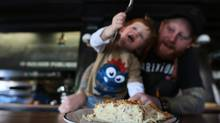 Chef Derek Damman watches his two-year old son Felix eat Quiche Lorraine at his new restaurant Maison Publique, in Montreal, January 5, 2013. (Christinne Muschi/The Globe and Mail)