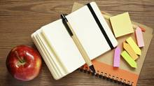 Notebooks, pens, stickers and apple (ksushsh/Getty Images/iStockphoto)
