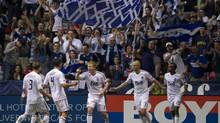 Vancouver Whitecaps FC Kenny Miller, second from right, celebrates his goal with his teammates during second half of MLS action against the Colorado Rapids in Vancouver on Sunday, September 23, 2012. (JONATHAN HAYWARD/THE CANADIAN PRESS)
