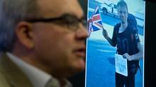 A photo of missing British tourist Tom Billings, 22, is displayed as his father Martin Billings speaks to the media during a news conference at Vancouver Police headquarters in Vancouver, B.C., on Monday December 9, 2013. (DARRYL DYCK For The Globe and Mail)