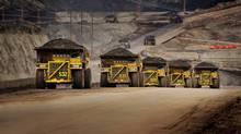 Caterpillar trucks working in the oil sands in Alberta. (CATERPILLAR INC.)
