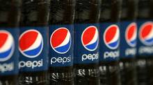 PepsiCo Inc. says slumping sales from Philadelphia's new sweetened-beverage tax are prompting layoffs of 80 to 100 workers at three distribution plants. (SeongJoon Cho/Bloomberg)