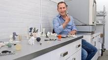 3-D printing is such a game-changing technology that its practitioners spend a lot of time and energy explaining it to potential customers, says Laurie Mirsky, 3DPhacktory's founder, posing here with a razor and other items printed in his shop. (Galit Rodan For The Globe and Mail)