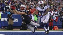 New England's Julian Edelman tries to catch the ball as Ronald Darby of the Buffalo Bills defends during Sunday's game in Buffalo. (Tom Szczerbowski/Getty Images)