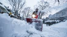 Tom McCann uses a snowblower to clear a sidewalk after a large snowstorm in Toronto, Wednesday March 2, 2016. (Mark Blinch For The Globe and Mail)