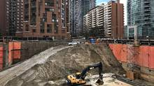 Construction equipment is parked at the bottom of a pit on the site of a new condominium complex off Redpath Avenue in Toronto, on April 1, 2017. (CHRIS HELGREN/REUTERS)