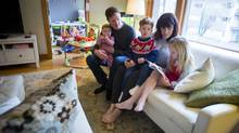 Amber and Rob Stefanson are pictured in their apartment with their children Mia, 7, Emmett, 3, and Olive, 10 months in Vancouver, British Columbia on December 13, 2015. (Ben Nelms For The Globe and Mail)