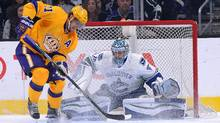 Los Angeles Kings centre Anze Kopitar can't get off a shot as Vancouver Canucks goalie Ryan Miller defends the net in the first period of the game at Staples Center on Monday, March 7, 2016. (Jayne Kamin-Oncea/USA Today Sports)