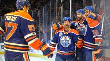 Edmonton Oilers center David Desharnais (middle) celebrates his goal against the Dallas Stars with Oilers left winger Benoit Pouliot and defenseman Darnell Nurse. (Walter Tychnowicz/USA Today Sports)