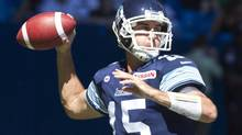 Toronto Argonauts quarterback Ricky Ray throws a pass against the Saskatchewan Roughriders during first half action in their CFL game in Toronto Saturday July 5, 2014. (FRED THORNHILL/THE CANADIAN PRESS)