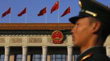 A paramilitary policeman stands guard in front of the Great Hall of the People, the venue of the 18th National Congress of the Communist Party of China in Beijing, Nov. 8, 2012. (Petar Kujundzic/REUTERS)