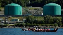 In this 2012 file photo, members of the Squamish and Tsleil-Waututh First Nations paddle canoes in Burrard Inlet to show opposition to the proposed expansion of the Trans Mountain pipeline. (DARRYL DYCK/THE CANADIAN PRESS)