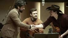 Oscar Isaac, left, Justin Timberlake, centre, and Adam Driver in a scene from Inside Llewyn Davis. (Alison Rosa/AP/CBS Films)