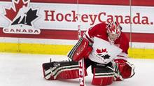 Canada's goalie Shannon Szabados stretches during warm-up prior to women's hockey action against the USA in Calgary, Alta., Thursday, December 12, 2013. (Larry MacDougal/THE CANADIAN PRESS)