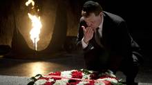 Canadian Foreign Minister, John Baird, lays a wreath at the Hall of Remembrance at the Yad Vashem Holocaust memorial, in Jerusalem, Monday, Jan. 30, 2012. (Sebastian Scheiner/AP/Sebastian Scheiner/AP)