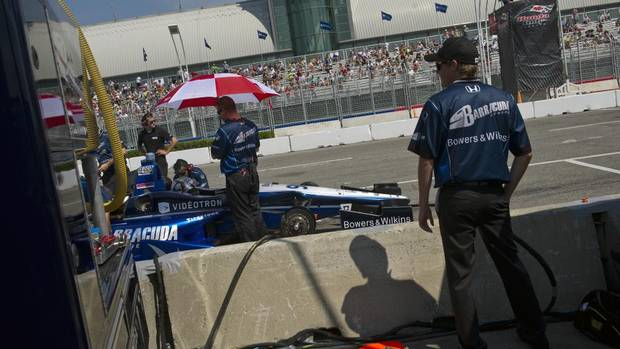 The pit crew for racer No. 98 Barracuda/Bryan Herta Autosports Honda Indy at the CNE, July 6, 2012. ( (Galit Rodan/The Globe and Mail)