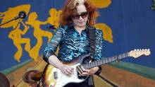 Bonnie Raitt performs at the New Orleans Jazz and Heritage Festival in New Orleans, Sunday, May 6, 2012. (Gerald Herbert/AP)