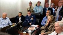 In this May 1, 2011 file image released by the White House and digitally altered by the source to diffuse the paper in front of Secretary of State Hillary Rodham Clinton, President Barack Obama and Vice President Joe Biden, along with with members of the national security team, receive an update on the mission against Osama bin Laden in the Situation Room of the White House in Washington. (Handout/Associated Press)