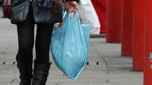 A woman carries a plastic bag on December 30, 2010 in Milan, Italy. The country is banning non-biodegradable polyethylene bags as of January 1, 2011. (Vittorio Zunino Celotto/Getty Images)