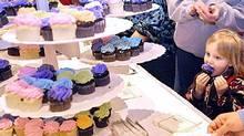 Tasting Bite Me's cupcakes.