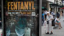 People walk past a bus shelter advertisement warning of the dangers of fentanyl on Granville Street in Vancouver, B.C., on Wednesday, Aug. 12, 2015. Fentanyl was detected in about one-third of the total 465 illicit drug overdose deaths in B.C. in 2015, up from 25 per cent in 2014, 15 per cent in 2013 and 5 per cent in 2012. (DARRYL DYCK For The Globe and Mail)