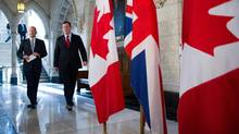 British Foreign Secretary William Hague, left, and Foreign Affairs Minister John Baird spoke at the Commons on Monday. (Sean Kilpatrick/THE CANADIAN PRESS)