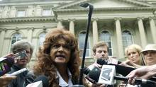 Terri-Jean Bedford, one of the appelants in a landmark case that's trying to overturn Canada's prositution laws, outside court on June 13. (Nathan Denette/The Canadian Press/Nathan Denette/The Canadian Press)