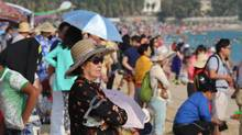 Hundreds of thousands of elderly now flee northern China's cold and smog to Sanya, a southern beach town that is among the country's most popular destinations for a new generation of snowbirds. (Nathan Vanderklippe/The Globe and Mail)