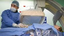 Dr. Marcial Fallas a Vascular surgeon at the Hospital Cla�?nica Ba�?blica in San Jose, Costa Rica November 25, 2010 during surgery on patient Jeanette Brooks who suffers from Multiple sclerosis. (John Lehmann/The Globe and Mail/John Lehmann/The Globe and Mail)