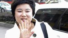 Wu Ying, president of Bense Holding Group, waves to journalists in this January 24, 2007 China Daily file photo.