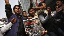 Activists of the Akhil Bharatiya Vidyarthi Parishad party, linked to India's main opposition Bharatiya Janata Party, shout slogans during a protest against Tarun Tejpal, editor-in-chief of India's leading investigative magazine, in New Delhi on Nov. 22, 2013. (ADNAN ABIDI/REUTERS)
