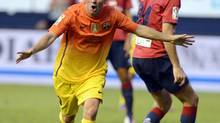 Barcelona's Lionel Messi celebrates a goal against Osasuna during their Spanish first division soccer match at Reyno de Navarra stadium in Pamplona August 26, 2012. (VINCENT WEST/Reuters)