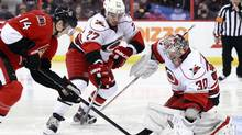 Carolina Hurricanes' Justin Faulk (C) and goalie Cam Ward stop a scoring attempt by Ottawa Senators' Colin Greening (L) during the second period of their NHL hockey game in Ottawa February 7, 2013. (Blair Gable/REUTERS)