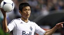 Vancouver Whitecaps Lee Young-pyo throws in the ball during the second half of their MLS soccer match against Montreal Impact in Vancouver, British Columbia March 10, 2012. REUTERS/Ben Nelms (Ben Nelms/Reuters)