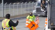 A unionized container trucker driver stops a non-unionized trucker on the picket lines outside the Port Metro Vancouver, March 10, 2014. (John Lehmann/The Globe and Mail)