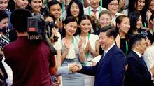 Chinese President Xi Jinpingshakes hands with delegates of Nazarbayev Summer Camp from Kazakhstan at Beijing's Great Hall of the People in Beijing June 24, 2014.
