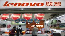 Customers talk to a salesperson at a Lenovo shop in Shanghai in this February 17, 2011 file photo. Lenovo Group Ltd, the world's No.2 PC maker by sales, reported a 59 percent rise in fourth-quarter net profit on May 23, 2012. (ALY SONG/Aly Song/Reuters)