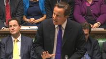 Britain's Prime Minister David Cameron, flanked by Deputy Prime Minister Nick Clegg, left, speaks about phone hacking to parliament in a still image taken from video in London July 20, 2011. Cameron on Wednesday defended the way his staff dealt with the police over allegations of phone-hacking and bribery at Rupert Murdoch's British newspapers . (REUTERS TV/Parbul TV via Reuters TV)
