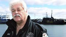 Paul Watson, head of the Sea Shepherd Conservation Society, stands on a dock near his vessel the Farley Mowat in Sydney, Nova Scotia, April 14, 2008. (Reuters/Paul Darrow)