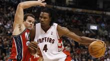 Toronto Raptors' Chris Bosh goes to the net against New Jersey Nets' Kris Humphries, left, during the first half of their NBA basketball game in Toronto, February 3, 2010. (MARK BLINCH)