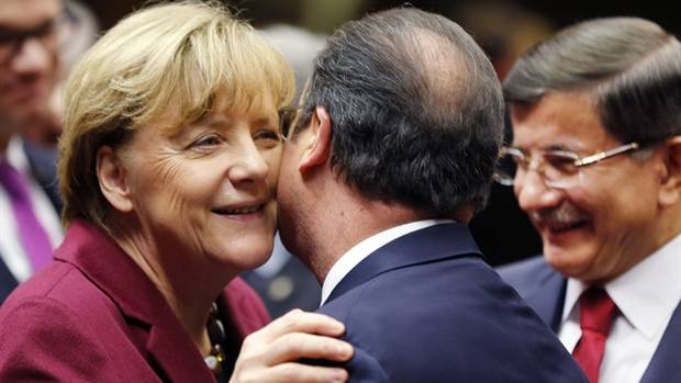 File photo: German Chancellor Angela Merkel welcomes French President Francois Hollande while Turkish Prime Minister Ahmet Davutoglu, right, looks on during an EU-Turkey summit at the EU Council building in Brussels on Sunday, Nov. 29, 2015.