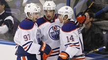 Edmonton Oilers' Ryan Nugent-Hopkins, left, and Taylor Hall, centre, celebrate Jordan Eberle's goal during the first period of their NHL hockey game against the St. Louis Blues in St. Louis, Missouri March 26, 2013. (Reuters)