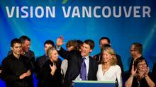 Vancouver Mayor Gregor Robertson, centre, is joined by his wife Amy, centre right, as they celebrate after he was re-elected in a civic election in Vancouver, B.C., on Nov. 19. The man on far left in black is Jinagh Farrouch Navas-Rivas. (Darryl Dyck/The Canadian Press/Darryl Dyck/The Canadian Press)