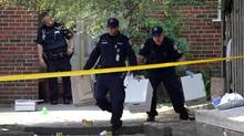 The Toronto Police Forensic Identification Unit collects evidence after a mass shooting. Today's topics: the politics of violence, hire education's value?; female athletes; garage sale safety ... and more (Deborah Baic/The Globe and Mail)